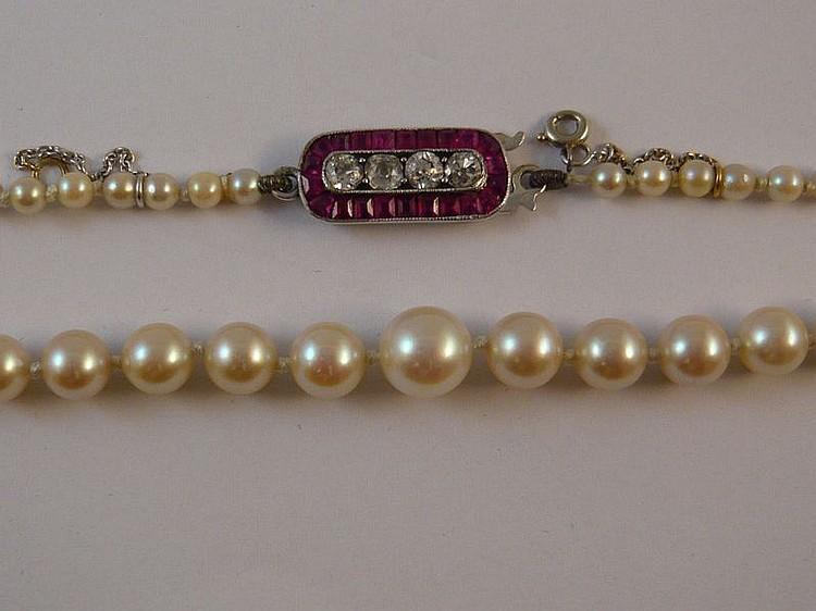 Bague en chute de jolies perles de culture