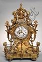 Pendule en bronze à patine dorée