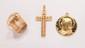 Lot de trois bijoux en or jaune comprenant un pendentif croix perlée, une médaille de la Vierge à décor émaillé, une bague à corbeille ajourée ornée d'une citrine rectangulaire.       Poids : 23,3 g.      An ensemble of three 18K gold jewels.