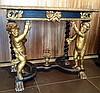 Table console en bois noirci et doré