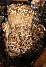 Un fauteuil bergère en velours frappé.   Epoque Louis XVI