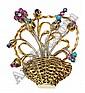 Prendedor diseño de canasta con flores en oro de 18 k , con rubies, zafiros turquesas y diamantes.