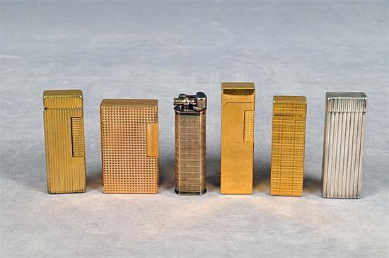 Lote de 6 encendedores. Distintas marcas, tamaños y diseños. Con estuches. Total de piezas: 6