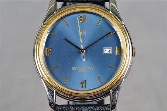 Reloj. Marca Givenchy (Nuevo). En acero y chapa. Mecanismo de cuarzo, sin batería. Diseño con caja circular, esfera azul.