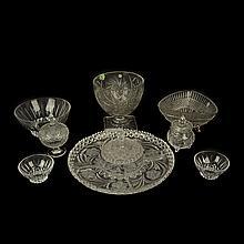 Lote de cristalería. Siglo XX. Diferentes diseños y tamaños. Consta de: botanero, frutero, hielera, 2 centros de mesa, otros. 14 pzs