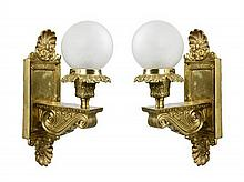 A PAIR OF VICTORIAN GILT METAL WALL SCONCES