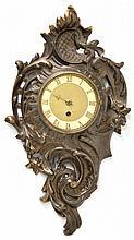 A GERMAN GILT BRONZE CARTEL CLOCK
