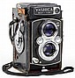 A VINTAGE YASHICA MAT-124 CAMERA WITH CASE