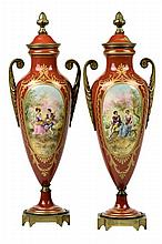 A PAIR OF SEVRES STYLE GILT METAL MOUNTED PORCELAIN URNS