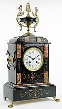 A FRENCH EMPIRE STYLE GILT METAL MOUNTED SLATE SAMUEL MARTI MANTEL CLOCK