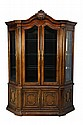 A LOUIS XV STYLE BOW FRONT GLAZED DISPLAY CABINET