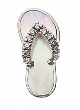 A 14 KARAT WHITE GOLD, DIAMOND, AND MOTHER-OF-PEARL CHARM
