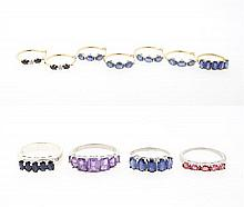 AN ASSEMBLED COLLECTION OF 10 KARAT GOLD AND STERLING SILVER JEWELRY ARTICLES 11 pieces total