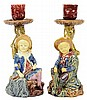 A PAIR OF CONTINENTAL MAJOLICA FIGURAL CANDLESTICKS