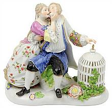 A ROYAL VIENNA PORCELAIN FIGURAL GROUP DEPICTING A COURTING COUPLE
