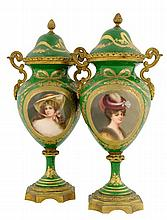 A PAIR OF SEVRES ORMOLU MOUNTED PORCELAIN URNS, SIGNED WAGNER