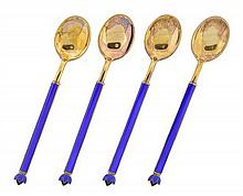 A SET OF FOUR NORWEGIAN DAVID ANDERSEN GOLD WASHED STERLING SILVER AND GUILLOCHE ENAMELED COFFEE SPOONS