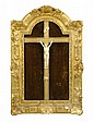 A GERMAN EXPRESSIONIST STYLE CARVED CRUCIFIX IN GILTWOOD FRAME