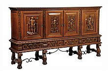 A SPANISH STYLE CARVED MAHOGANY SIDEBOARD
