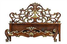 AN ITALIAN BAROQUE STYLE PARCEL GILTWOOD BED