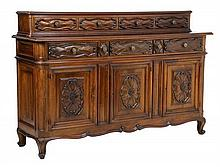AN ITALIAN BAROQUE STYLE CARVED WALNUT SIDEBOARD