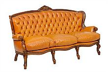 AN ITALIAN BAROQUE STYLE LEATHER SETTEE