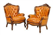 A PAIR OF ITALIAN BAROQUE STYLE LEATHER ARMCHAIRS