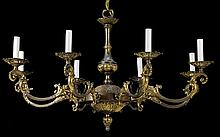 AN ITALIAN BAROQUE STYLE BRONZE EIGHT-LIGHT CHANDELIER