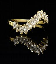 AN 18 KARAT YELLOW GOLD MARQUIS DIAMOND WAVE RING