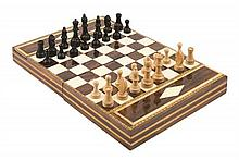 A CONTINENTAL ROSEWOOD, SATINWOOD, EBONY, BONE AND MOTHER-OF-PEARL INLAID TRAVEL CHESSBOARD