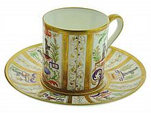 A FRENCH PORCELAIN DEMITASSE CUP AND SAUCER