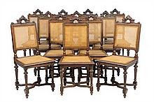 A SET OF TWELVE RENAISSANCE REVIVAL DINING CHAIRS