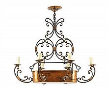 A GOTHIC REVIVAL HAMMERED COPPER SIX-LIGHT CHANDELIER