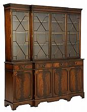A GEORGE III STYLE MAHOGANY BREAKFRONT CABINET
