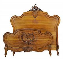 A FRENCH LOUIS XV STYLE BED