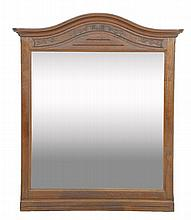 A FRENCH PROVINCIAL STYLE MIRROR