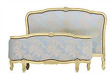 A FRENCH LOUIS XV STYLE PAINTED AND UPHOLSTERED BED