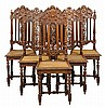 A SET OF SIX RENAISSANCE REVIVAL SIDE CHAIRS