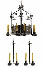 A GOTHIC REVIVAL WROUGHT IRON EIGHT-LIGHT CHANDELIER AND ACCOMPANYING WALL SCONCES