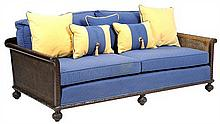 A FRENCH PROVINCIAL STYLE CANED SOFA