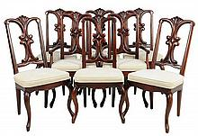 A SET OF EIGHT FRENCH NEOCLASSICAL STYLE DINING CHAIRS