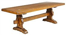 A FRENCH PROVINCIAL STYLE OAK TRESTLE TABLE