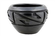 A SANTA CLARA PUEBLO BLACKWARE POTTERY JAR BY BETTY TAFOYA