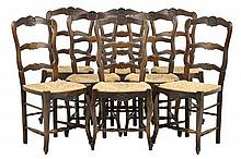 A SET OF EIGHT FRENCH PROVINCIAL STYLE CHAIRS