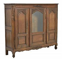 A FRENCH PROVINCIAL STYLE CABINET