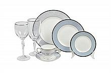 A WEDGWOOD PORCELAIN DINNER SERVICE FOR TEN AND A SET OF WATERFORD CRYSTAL GLASSES