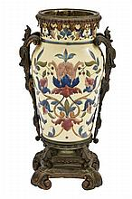 A CONTINENTAL BRONZE MOUNTED PORCELAIN VASE