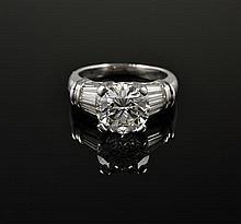 A 2.6 CARAT CENTER DIAMOND AND PLATINUM RING