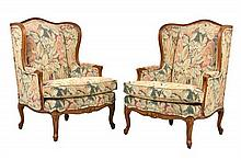 A PAIR OF FRENCH PROVINCIAL STYLE WINGBACK CHAIRS