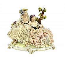 A GERMAN PORCELAIN LACE FIGURAL GROUP